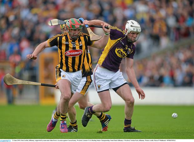 21 June 2015; Eoin Larkin, Kilkenny, supported by team-mate John Power, in action against Ciaran Kenny, Wexford. Leinster GAA Hurling Senior Championship, Semi-Final, Kilkenny v Wexford, Nowlan Park, Kilkenny. Picture credit: Piaras Ó Mídheach / SPORTSFILE
