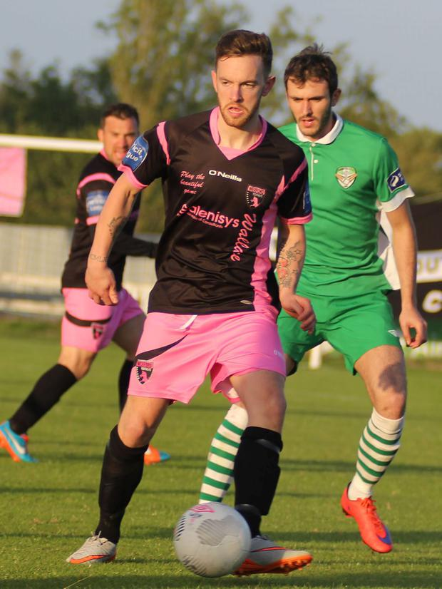 Wexford's Danny Furlong and Cabinteely's Kevin Knight