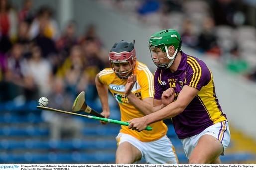 22 August 2015; Conor McDonald, Wexford, in action against Maoi Connolly, Antrim. Bord Gáis Energy GAA Hurling All Ireland U21 Championship, Semi-Final, Wexford v Antrim. Semple Stadium, Thurles, Co. Tipperary. Picture credit: Dáire Brennan / SPORTSFILE