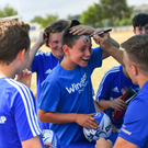 One young rugby fan makes sure everyone knows he got Josh van der Flier's autograph at last week's camp
