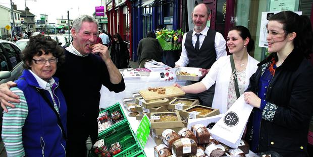 Gourmet Greystones Festival: Marie and Peter Prunty sampling Donnybrook Fair's wares from Gavin Kelly, Jill Quinn and Rebecca Bell
