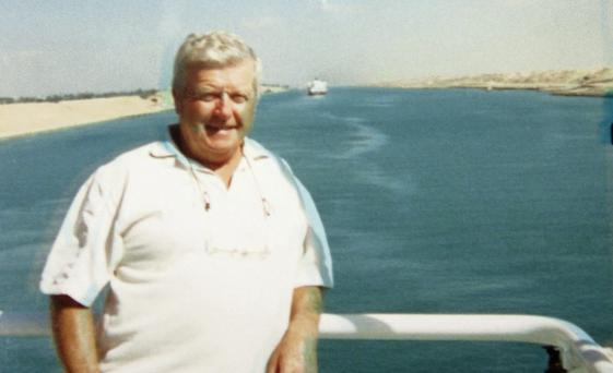 Capt Danny O'Neill on the bridge of his ship in the Suez Canal in the 1990s; with a crew member.