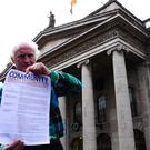 Duncan Stewart outside the GPO, in Dublin displaying a copy of the Community Energy Proclamation