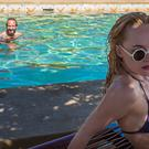 Dakota Johnson and Ralph Fiennes in A Bigger Splash