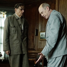 Joseph Stalin (Adrian McLoughlin) lies dead on the floor while Malenkov (Jeffrey Tambor) and Khrushchev (Steve Buscemi) discuss what to do next in The Death Of Stalin.