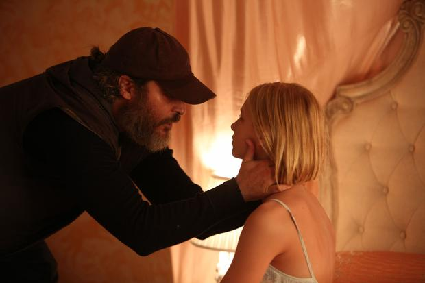 Joaquin Phoenix as Joe and Ekaterina Samsonov as Nina in You Were Never Really Here.