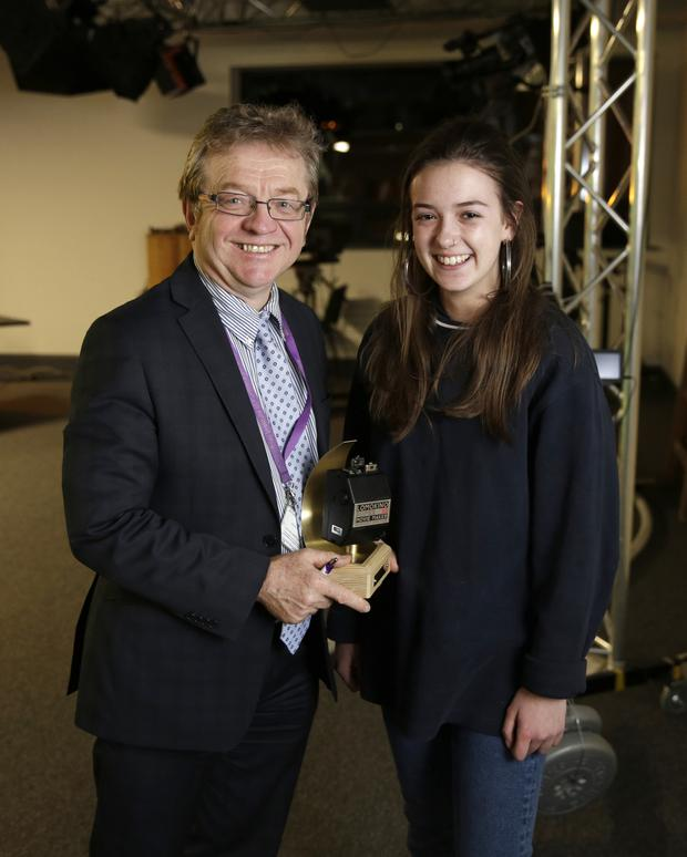 Principal Raymond Tedders presents the award for shot of the year to first year student Megan Delaney.