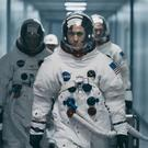 Lukas Haas as Michael Collins, Ryan Gosling as Neil Armstrong and Corey Stoll as Buzz Aldrin in First Man.