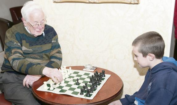 Vincent Denard who celebrated his 90th birthday recently plays one of the youngest members of Bray Chess Club, Sean Kilcullen (10).