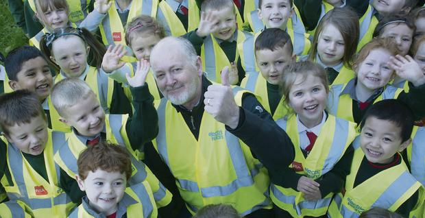 Paul Armstrong of Electric Ireland with children from St Philomena's Primary School after they were presented with their hi-vis vests.