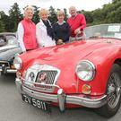 Carol Dungan, Irene Clarke, Ethni Seymour and Tom Clarke from the MG club with a 1959 MGA