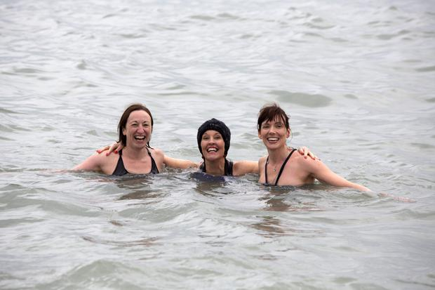 Catherine Stanley, Aoife Kavanagh and Bronagh Daly enjoying their Christmas Day Swim in Greystones