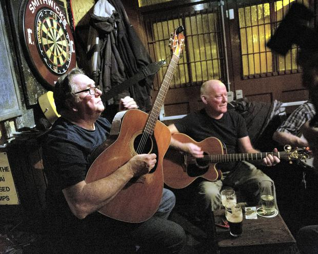 Pat Byrne and Mick Heffernan play in the bar of the Royal Hotel as part of the charity ball for the annual Banjo & Bovril Festival