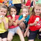 Aoife Roberts, Evanna Shortt, Ruby Clancy and Tara Byrne enjoying their ice cream after the raising of the Green and Amber flags at Moneystown National School