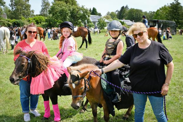Grace and Kathlyn Smyth with Nicole and Andrea Robinson at the Kilmacanogue Horse Show