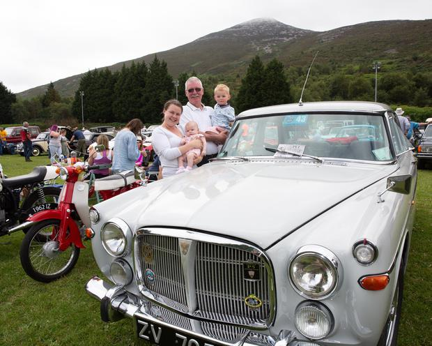 Shay Duffy with Elaine Shortt and Maisie and Jackson Thomas and his Rover P5B at the Garden of Ireland Vintage Club Tom Kennedy Memorial Vintage Show at Kilmac GAA Club grounds