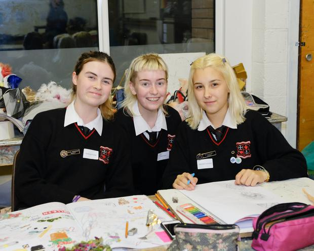 Students Vanessa Foster, Sara Egan and Hannah Leonard helping out at the Loreto Secondary School open night.