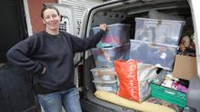 Isolda Heavey loading up the eighth van on Monday afternoon at Prelude Arts Centre with donations for Refugee Solidarity