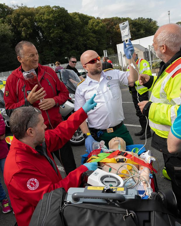 Dr David Mendez of WRR demonstrating a blood transfusion with Andy O'Toole of the NAS, mountain rescue volunteer Paul Butcher and Blood Bikes volunteer Michael Noonan at the Save a Life Day at Sinnott Autos in Wicklow town last year