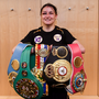 Katie Taylor with her belts after defeating Delfine Persoon at Madison Square Garden in New York in June