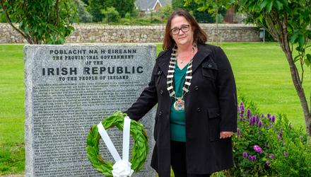 Cllr Aoife Flynn Kennedy with a wreath at the memorial in the People's Park, Bray