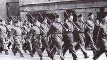 Soldiers march through the streets