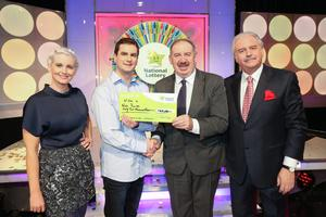Wining Streak co-host Sinead Kennedy, Niall Roche, the winning player, Peter Plunkett, head of IT at the National Lottery, and Marty Whelan