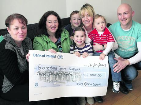 Team Gavin Glynn present their new year swim cheque to Greystones Cancer Support: (L-R) Sonia Walsh GCS, Catherine Malone, Conor, Lucy, Jayne, Gavin adn John Glynn