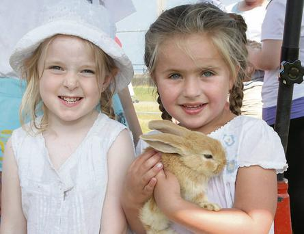 Abigail Kennedy and Nadine Conroy with a bunny at the Glenroe Travelling Farm at the Summerfest Family Fiesta.