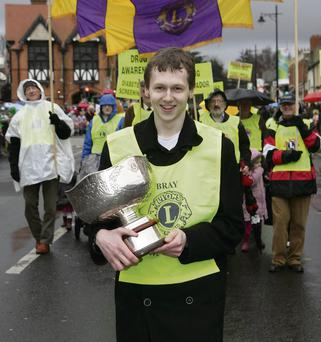 Adam Harris International Young Ambassador for the Lions Club 2013 walking in the St Patricks Parade in Bray.
