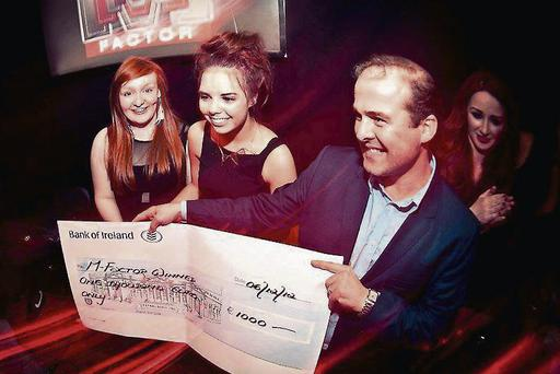 Winners of last year's M'Factor Sinead and Ailish being presented with their prize by John Duggan of the Martello.