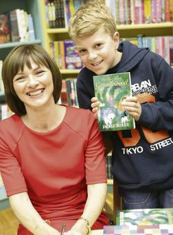 Jackie Burke launches her book 'The Secrets of Grindlewood' at Dubray Books: Jackie with young fan Ben Murphy
