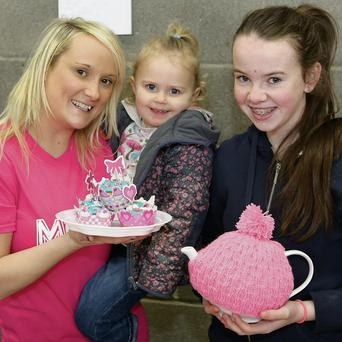 Merryn's aunty Anne-Noelle and sister Cora doling out the teas and cakes with Saoirse Brady during the coffee morning at Wolfetone Youth Club.