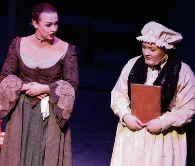 Sadbh Corish as Mrs Reed and Aoife Ní Dhonnchada as Bessie.