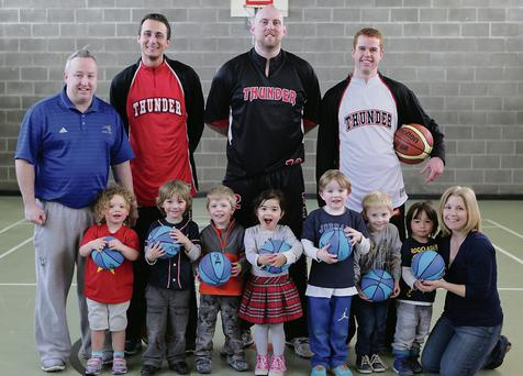 Members of the Basketball Team meet Moothergoose Montessori at Wolfetone Community Centre: David Baker, Coach, Michael Goj, Conor Gallagher and Alex Zuran with Lua Pulido, Michael Byrne, Andrew Lee, Beibhin McGuinness, Ryan Baker, Mark Killey, Óisín McGuinness, Sinead Stalton.