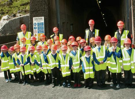 Pupils of Scoil Chaoimhín Naofa, Glendalough, and the Turlough Hill Tour Guides outside the tunnel.