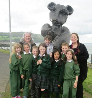 Sue Wyatt with children by the teddy bear statue in Greystones.