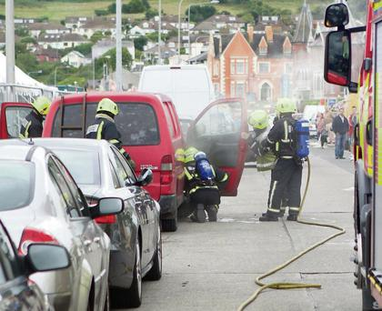 Bray Firemen attending to a van on fire at the Pavillion on Bray Seafront