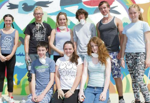 At North Beach with the mural, Greystones Youth Group members John O'Connor, Aoise Whooley, Eilish Holohan, Niamh Gurrrin, Ciana McLoughlin, artist Dara Kennedy, Emma Kieran, Jack Doyle and Adam Judge