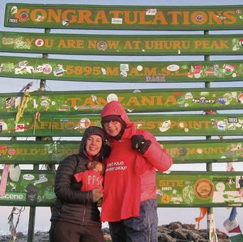 Anne and Francesca Hunt celebrate reaching the summit of Mount Kilimanjaro