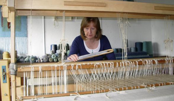 Muriel Beckett at her loom