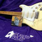 Hozier's signed guitar and album which he donated to Purple House for their fundraising auction