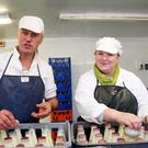 Arthur Craigie and Margaret O'Rourke adding the all-important foil seals to the distinctive Dunlavin Dairy bottles