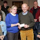 Cheque presentation from the Garden of Ireland Vintage Club to Bray Rotary with the proceeds from the Tom Kennedy Memorial Vintage Car Show: Eileen Kennedy presents the cheque to Gary King of behalf of Rotary