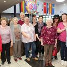 Clare Kilbride (centre, in white top) celebrates 60 years of Kilcoole Music Festival with the committee