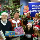 The team at East Coast FM launching the 'Give a Gift' campaign