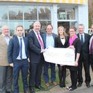 Philip Watt, Chief Executive Officer of Cystic Fibrosis Ireland (third from left) and Fergal Smyth, Fundraising Manager (second from right) accept the cheque from Dave Crowley, Fionn Crowley, Ger Crowley, Meghan Crowley, Gillian Mangan and Michael Dempsey of Row Around Ireland