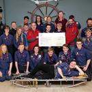 5th Wicklow Venture Scouts presenting a cheque for 1150 euro to Rob Creevey and John Kavanagh on behalf of the Dublin Wicklow Mountain Rescue Team raised by Aaron Pearse and Ryan Jeffares with a non-uniform day in Pres Bray and added funds by the scouts