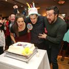 Daniel blows out the candles with a little help from his sister and brother, Aime and Ben
