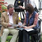 Terry Wogan looking at old family photographs with Una Wogan during his visit to Enniskerry in 2011